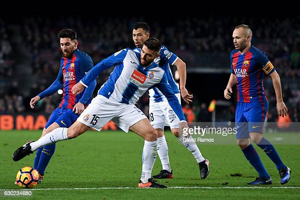 Lionel Messi of FC Barcelona and Andres Iniesta of FC Barcelona competes for the ball with RCD Espanyol players during the La Liga match between FC...