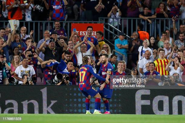 Lionel Messi of FC Barcelona and Antoine Griezmann celebrates the 1-0 during the Liga match between FC Barcelona and Villarreal CF at Camp Nou on...
