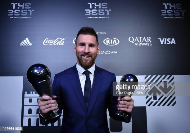 Lionel Messi of FC Barcelona and Argentina poses with the The Best FIFA Men's Player Award and The FIFA FIFPro Men's World11 Award trophies during...