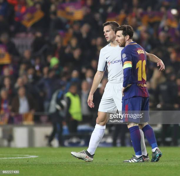 Lionel Messi of FC Barcelona and Cesar Azpilicueta of Chelsea are seen during the UEFA Champions League Round of 16 Second Leg match FC Barcelona and...