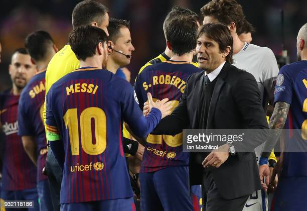 Lionel Messi of FC Barcelona and Chelsea manager Antonio Conte are seen during the UEFA Champions League Round of 16 Second Leg match FC Barcelona...