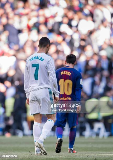 Lionel Messi of FC Barcelona and Cristiano Ronaldo of Real Madrid walk off pitch during La Liga match between Real Madrid and FC Barcelona at...