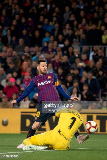 Lionel Messi of FC Barcelona and goalkeeper Geronimo Rulli of Real Sociedad battle for the ball during the La Liga match between FC Barcelona and...