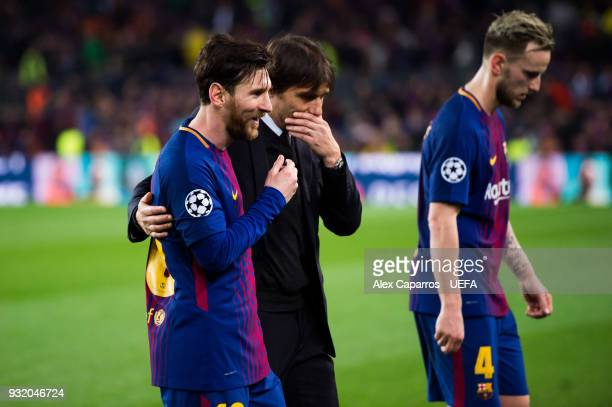 Lionel Messi of FC Barcelona and Head Coach Antonio Conte of Chelsea FC speak as they leave the pitch after the UEFA Champions League Round of 16...