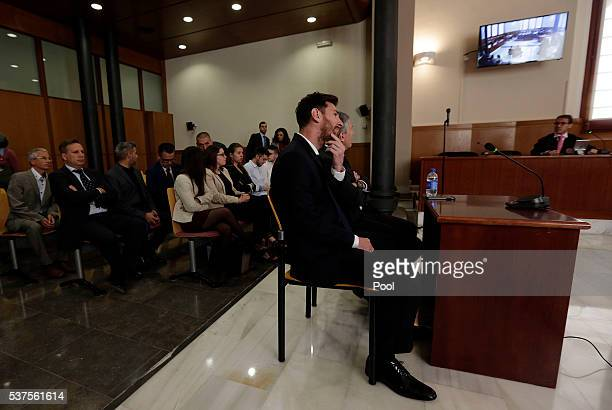 Lionel Messi of FC Barcelona and his father Jorge Horacio Messi seen inside the court during the third day of the trial on June 2 2016 in Barcelona...