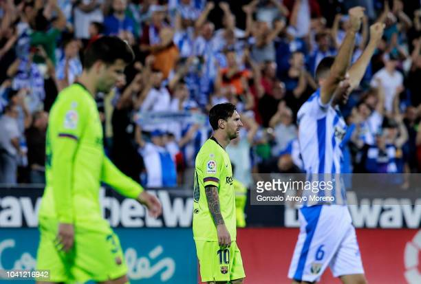 Lionel Messi of FC Barcelona and his teammate Gerard Pique leaves the pitch after the La Liga match between CD Leganes and FC Barcelona at Estadio...
