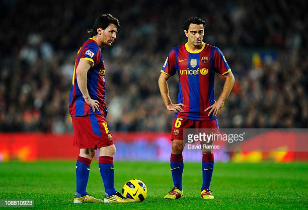 Lionel Messi of FC Barcelona and his teammate Xavi Hernandez look on during the La Liga match between Barcelona and Villarreal CF at Camp Nou Stadium...