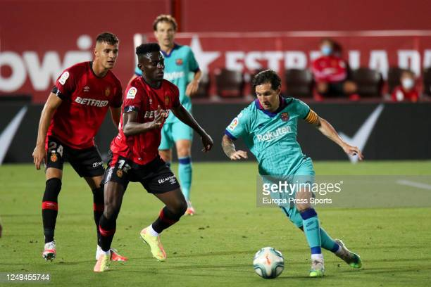 Lionel Messi of FC Barcelona and Iddrisu Baba of Mallorca in action during the spanish league LaLiga football match played between RCD Mallorca and...