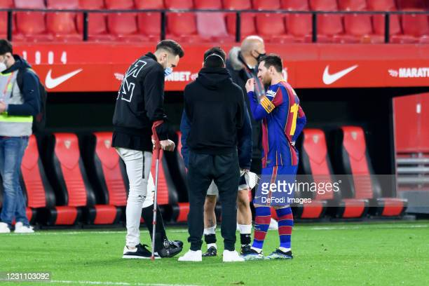 Lionel Messi of FC Barcelona and Lucas Ocampos of Sevilla FC speak during the Copa del Rey Semi Final First Leg at Estadio Ramon Sanchez Pizjuan on...