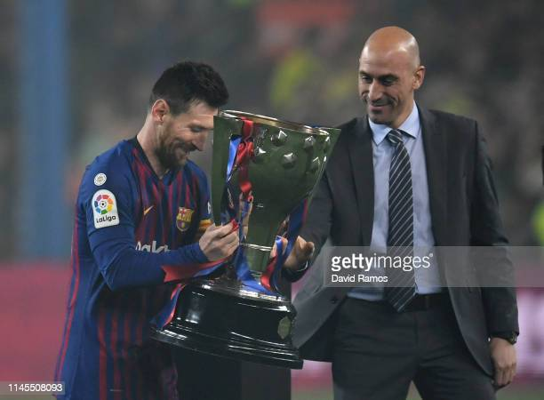 Lionel Messi of FC Barcelona and Luis Rubiales President of the RFEF with the La Liga Trophy as Barcelona win La Liga following their victory in the...
