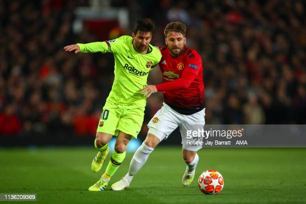 Lionel Messi of FC Barcelona and Luke Shaw of Manchester United during the UEFA Champions League Quarter Final first leg match between Manchester...