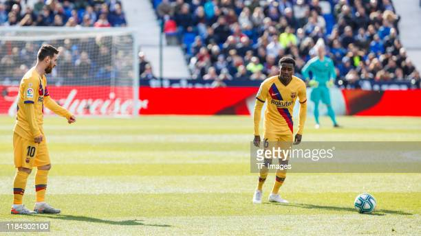 Lionel Messi of FC Barcelona and Moussa Wague of FC Barcelona control the ball during the Liga match between CD Leganes and FC Barcelona at Estadio...