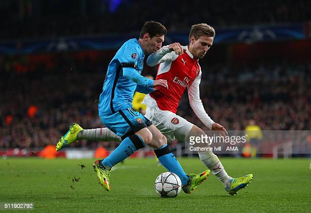 Lionel Messi of FC Barcelona and Nacho Monreal of Arsenal during the UEFA Champions League match between Arsenal and Barcelona at the Emirates...