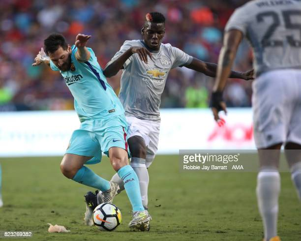 Lionel Messi of FC Barcelona and Paul Pogba of Manchester United during the International Champions Cup 2017 match between FC Barcelona and...