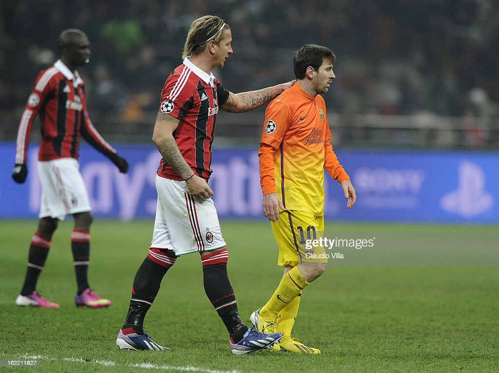 Lionel Messi of FC Barcelona and Philippe Mexes of AC Milan (L) during the UEFA Champions League Round of 16 first leg match between AC Milan and Barcelona at San Siro Stadium on February 20, 2013 in Milan, Italy.