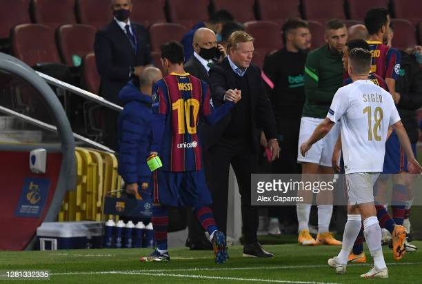 Lionel Messi of FC Barcelona and Ronald Koeman, Head Coach of FC Barcelona interact following their sides victory in the UEFA Champions League Group...