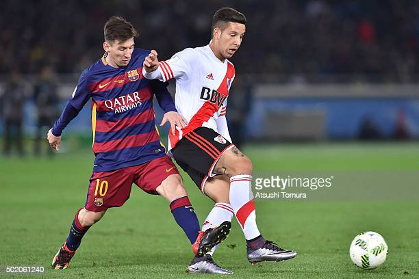 Lionel Messi of FC Barcelona and Sebastian Driussi of River Plate compete for the ball during the final match between River Plate and FC Barcelona at...