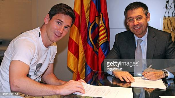 Lionel Messi of FC Barcelona and the FC Barcelona President Josep Maria Bartomeu pose during the signing of his new contract with FC Barcelona on May...