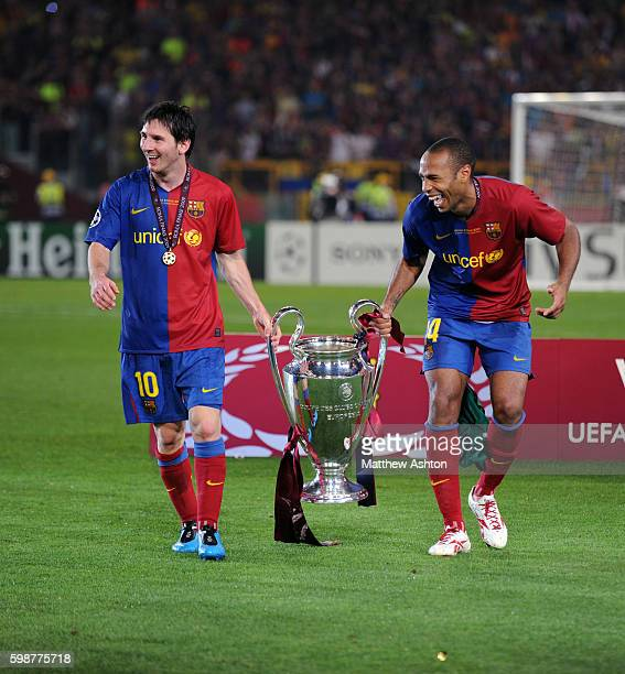 Lionel Messi of FC Barcelona and Thierry Henry of FC Barcelona carry the trophy after winning the UEFA Champions League Final 2009 defeating...