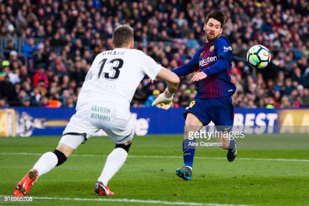 Lionel Messi of FC Barcelona and Vicente Guaita of Getafe CF run for the ball during the La Liga match between Barcelona and Getafe at Camp Nou on...