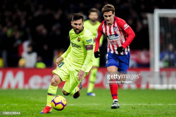 Lionel Messi of FC Barcelona Antoine Griezmann of Atletico Madrid during the La Liga Santander match between Atletico Madrid v FC Barcelona at the...