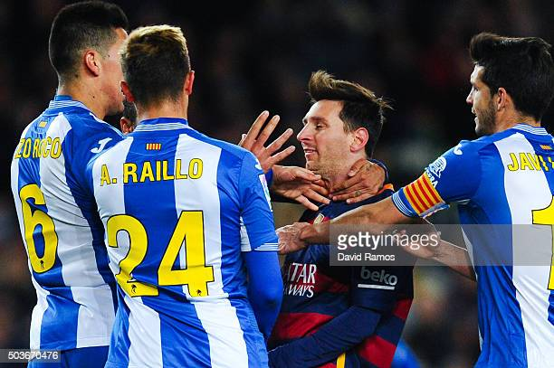 Lionel Messi of FC Barcelona argues with RCD Espanyol players during the Copa del Rey Round of 16 first leg match between FC Barcelona and RCD...