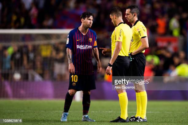 Lionel Messi of FC Barcelona argues with referee Jesus Gil Manzano after the La Liga match between FC Barcelona and Girona FC at Camp Nou on...