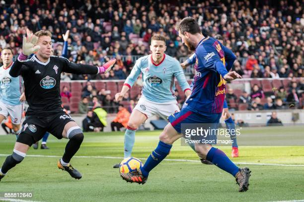 Lionel Messi of FC Barcelona attempts a kick while being defended by Goalkeeper Ruben Blanco Veiga of RC Celta de Vigo during the La Liga 201718...