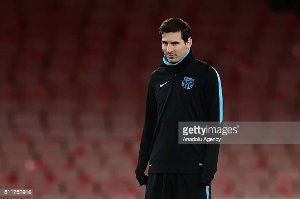 Lionel Messi of FC Barcelona attends a training session prior to the Champions League round of 16 first leg soccer match between Arsenal and...