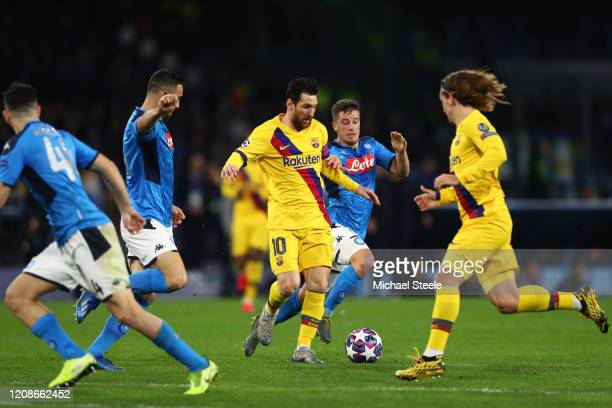 Lionel Messi of FC Barcelona battles for possession with Diego Demme of SSC Napoli and Nikola Maksimovic of Napoli during the UEFA Champions League...