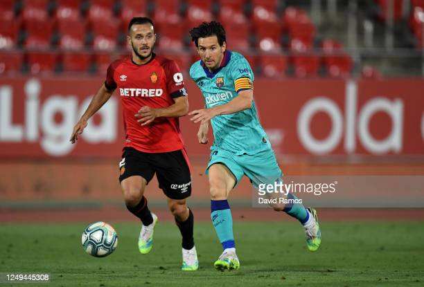 Lionel Messi of FC Barcelona battles for possession with Joan Sastri of RCD Mallorca during the La Liga match between RCD Mallorca and FC Barcelona...