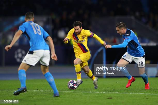 Lionel Messi of FC Barcelona battles for possession with Piotr Zielinski of SSC Napoli and Nikola Maksimovic of Napoli during the UEFA Champions...