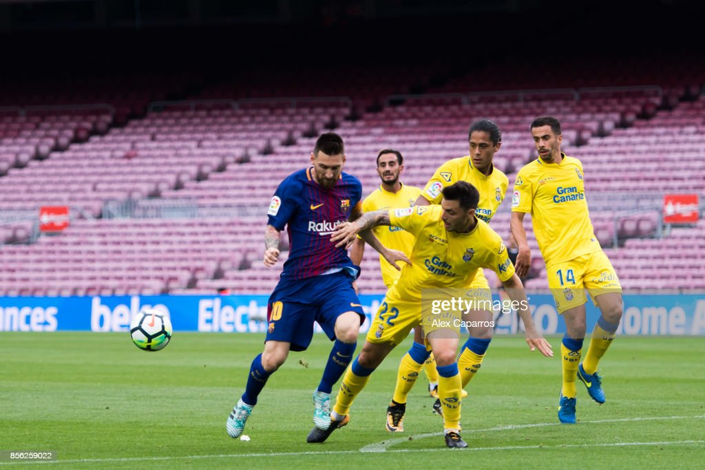 Lionel Messi of FC Barcelona battles for the ball with Ximo Navarro of UD Las Palmas during the La Liga match between Barcelona and Las Palmas at Camp Nou on October 1, 2017 in Barcelona, Spain. The match is played with empty stands after the events occured in Catalonia during the voting of a Catalonia independence referendum declared illegal and undemocratic by the Spanish government.