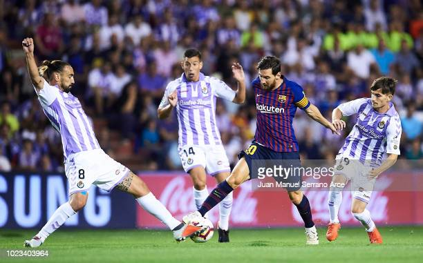 Lionel Messi of FC Barcelona being followed by Borja Fernandez and Toni Villa of Real Valladolid CF during the La Liga match between Real Valladolid...