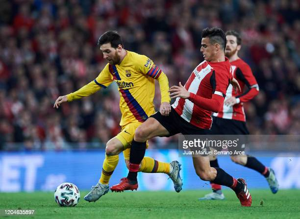 Lionel Messi of FC Barcelona being followed by Dani Garcia of Athletic Club during the Copa del Rey quarter final match between Athletic Bilbao and...