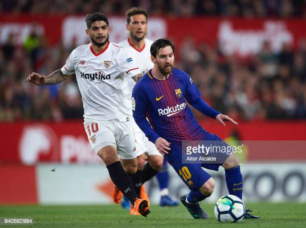Lionel Messi of FC Barcelona being followed by Ever Banega of Sevilla FC during the La Liga match between Sevilla CF and FC Barcelona at Estadio...