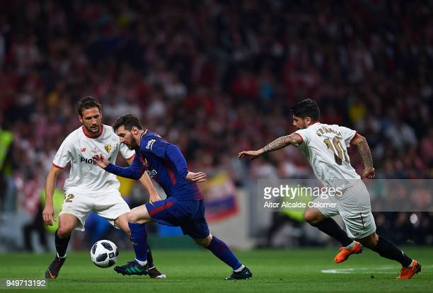 Lionel Messi of FC Barcelona being followed by Franco Vazquez of Sevilla FC and Ever Banega of Sevilla FC during the Spanish Copa del Rey match...