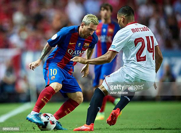 Lionel Messi of FC Barcelona being followed by Gabriel Mercado of Sevilla FC during the match between Sevilla FC vs FC Barcelona as part of the...