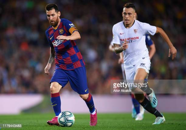 Lionel Messi of FC Barcelona being followed by Lucas Ocampos of Sevilla FC during the Liga match between FC Barcelona and Sevilla FC at Camp Nou on...