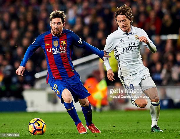 Lionel Messi of FC Barcelona being followed by Luka Modric of Real Madrid CF during La Liga match between FC Barcelona and Real Madrid CF at Camp Nou...
