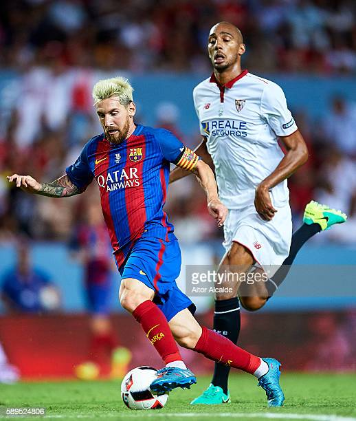 Lionel Messi of FC Barcelona being followed by Steven N'Zonzi of Sevilla FC during the match between Sevilla FC vs FC Barcelona as part of the...