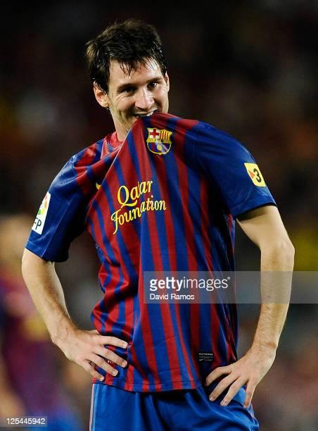 Lionel Messi of FC Barcelona bites his shirt during the La Liga soccer match between FC Barcelona and CA Osasuna at Camp Nou Stadium on September 17...