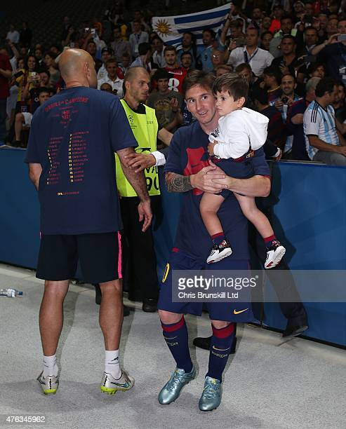 Lionel Messi of FC Barcelona carries his son Thiago following the UEFA Champions League Final match between Juventus and FC Barcelona at the...