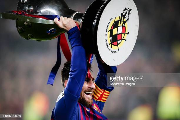 Lionel Messi of FC Barcelona celebrate the Championship with the trophy during the Spanish Copa del Rey match between FC Barcelona v Levante at the...