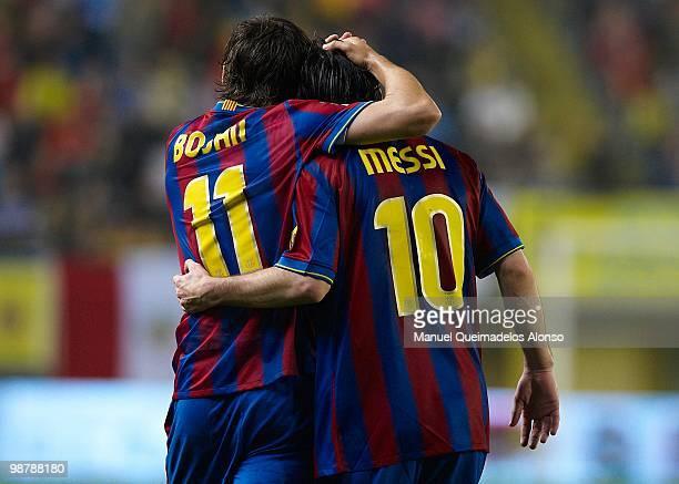 Lionel Messi of FC Barcelona celebrate with his teammate Bojan Krkic during the La Liga match between Villarreal CF and FC Barcelona at El Madrigal...