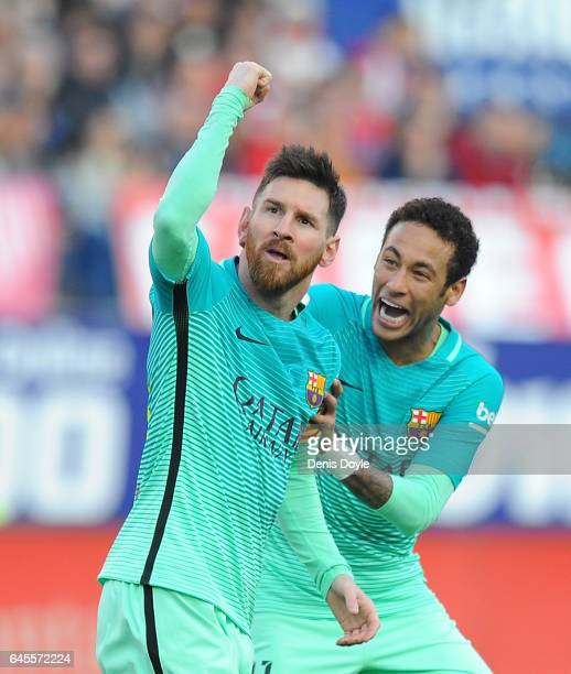 Lionel Messi of FC Barcelona celebratea with Neymar after scoring his 2nd goal during the La Liga match between Club Atletico de Madrid and FC...
