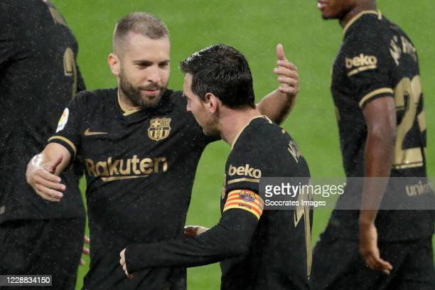 Lionel Messi of FC Barcelona celebrates 02 with Jordi Alba of FC Barcelona during the La Liga Santander match between Celta de Vigo v FC Barcelona at...