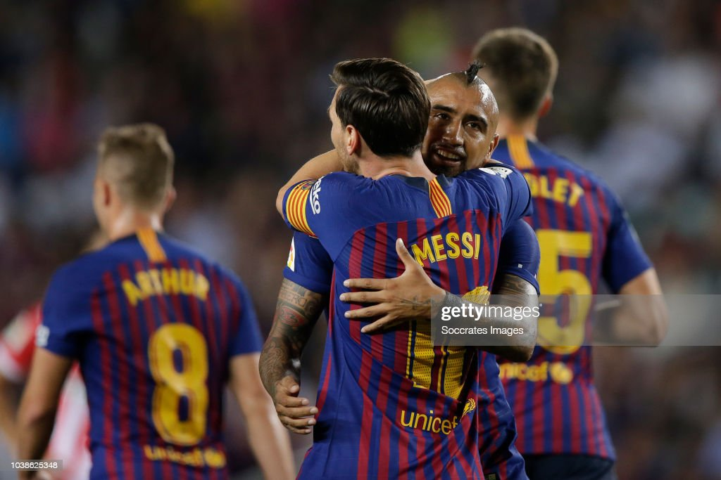 f8b3c9d5a Lionel Messi of FC Barcelona celebrates 1-0 with Arturo Vidal of FC ...