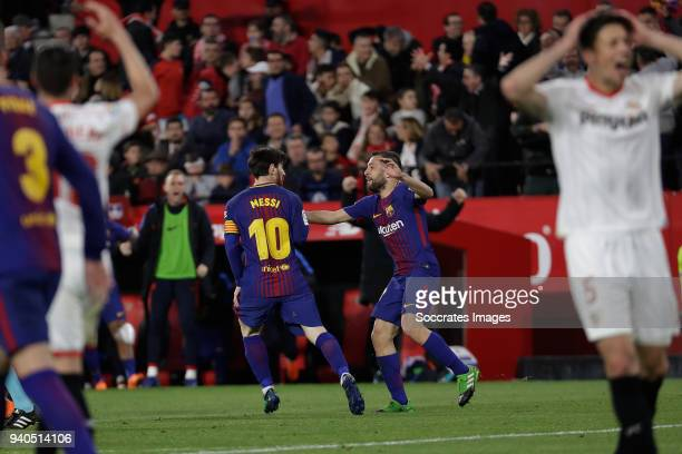 Lionel Messi of FC Barcelona celebrates 22 with Jordi Alba of FC Barcelona during the La Liga Santander match between Sevilla v FC Barcelona at the...
