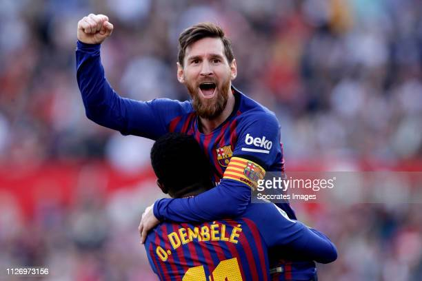 Lionel Messi of FC Barcelona celebrates 2-2 with Ousmane Dembele of FC Barcelona during the La Liga Santander match between Sevilla v FC Barcelona at...